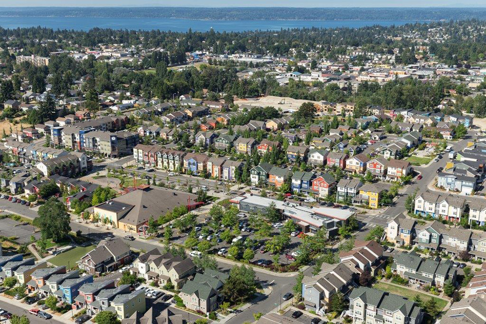 Aerial of the Greenbridge neighborhood with Puget Sound in the distance