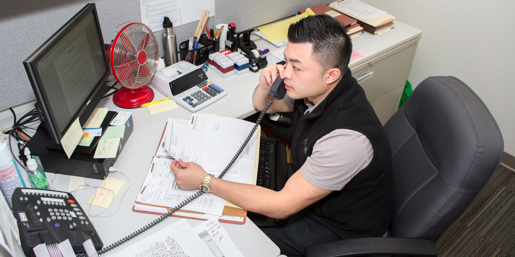 KCHA employee working at their desk