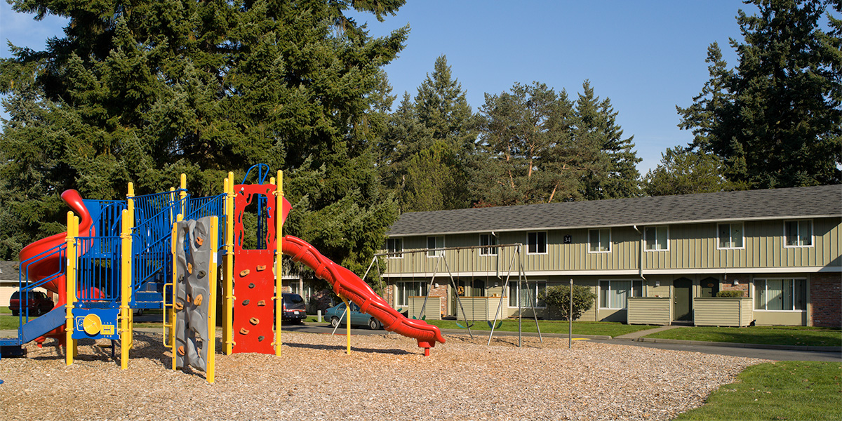 Affordable rental housing apartment complex with playground